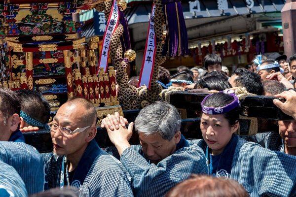 People carry a mikoshi, sanja matsuri, asakusa, tokyo, japan